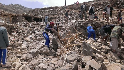 Villagers_scour_rubble_for_belongings_scattered_during_the_bombing_of_Hajar_Aukaish_-_Yemen_-_in_April_2015